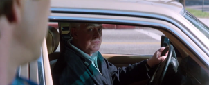 l'arme fatale 2 Arjen Rudd dans sa voiture observant martin