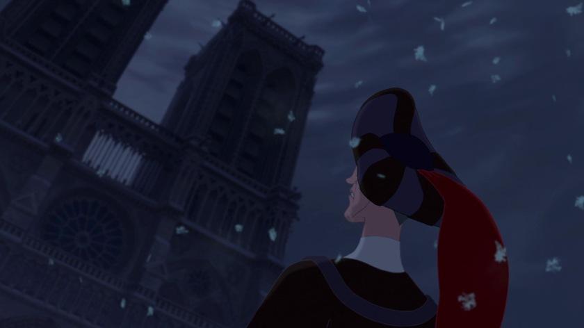 le bossu de notre dame frollo sous la neige face à notre dame