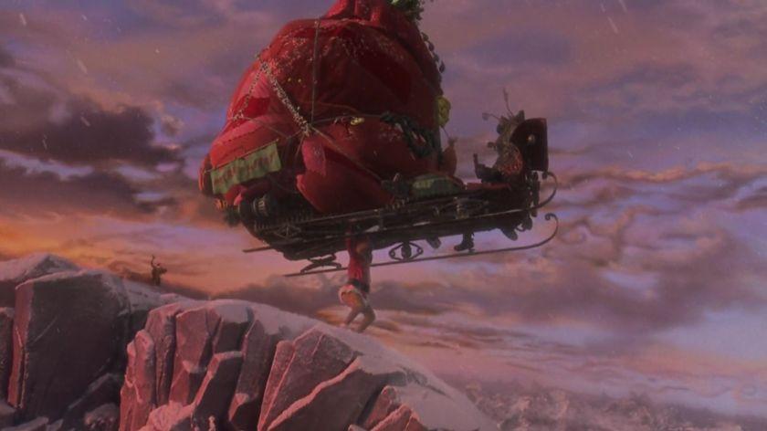 Le grinch 2000 le grinch soulevant son traineau chargé des cadeaux volés aux choux