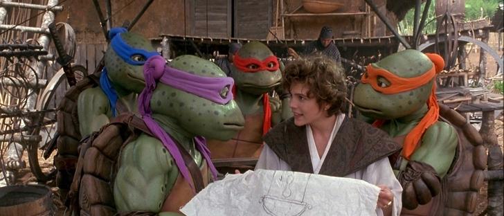 les tortues ninja 3 april tenant un plan du sceptre magique