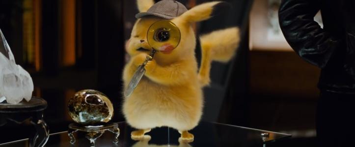Détective pikachu film pikachu tenant une loupe