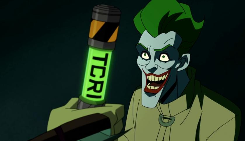 Batman Vs Tmnt 2019 Le joker en camisole de force ricane pendant que Shredder lui montre une fiole de mutagene