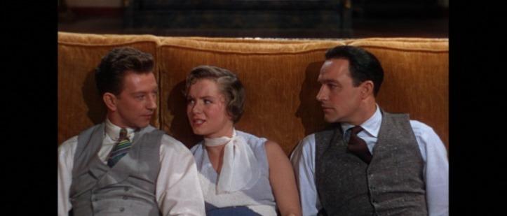 Chantons sous la pluie Donald O'connor Debbie Reynolds et Gene Kelly assis par terre