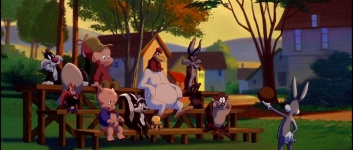 Space Jam Bugs Bunny sur un terrain de basket montre un ballon à ses amis les looney tunes assis sur un banc