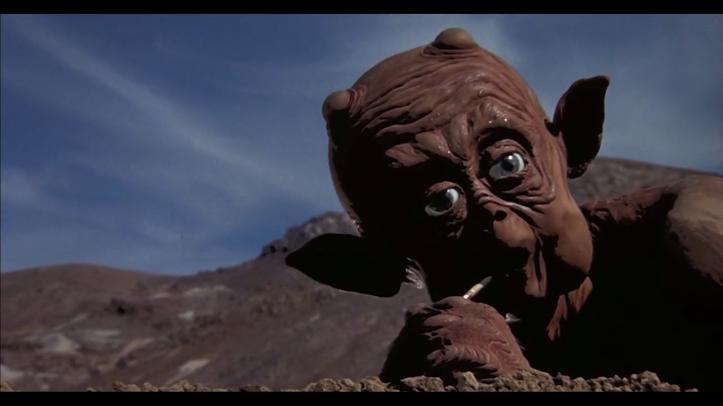 Mac_et_moi-alien-aspirant-avec-une -paille-l'eau-du-sol