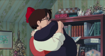 Kiki-la-petite-sorcière-le-père-de-kiki-prend-sa-fille-dans-ses-bras